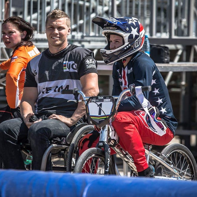 Sam Willoughby, left, and Alise Willoughby, right, team up as a coach and athlete BMX duo poised to star at the Tokyo Olympics.