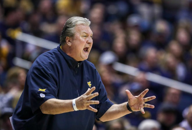 West Virginia coach Bob Huggins reacts on the sideline during a game against Kansas State.