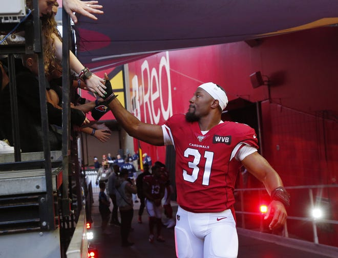 Arizona Cardinals running back David Johnson (31) shakes hands with fans before playing against the Cleveland Browns at State Farm Stadium December 15, 2019.