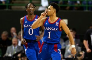 Kansas guard Devon Dotson reacts after scoring during the first half of his team