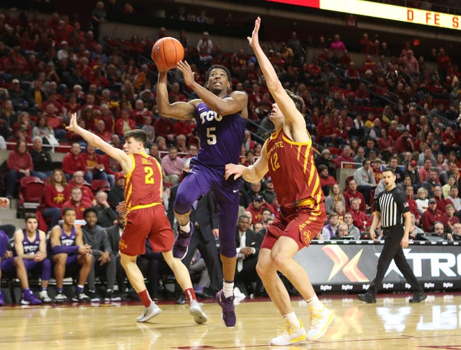 TCU guard Jaire Grayer (5) scores in front of Iowa State forward Michael Jacobson during their game at Hilton Coliseum.