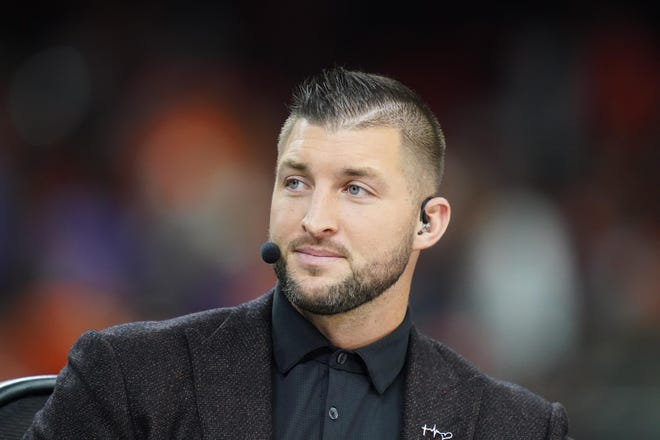 Tim Tebow before the College Football Playoff national championship game between the Clemson Tigers and the LSU Tigers at Mercedes-Benz Superdome.