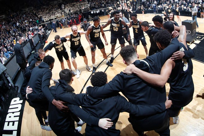 Purdue Boilermakers huddle up before the game against the Rutgers Scarlet Knights at Mackey Arena.