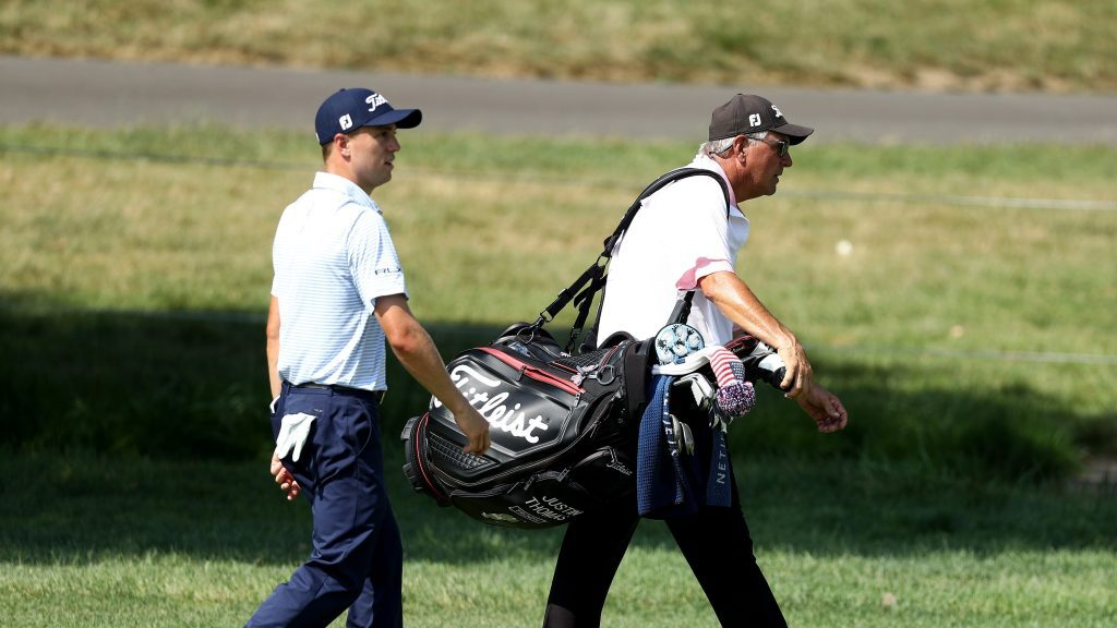 Mike Thomas caddies for son Justin when regular caddie can't finish