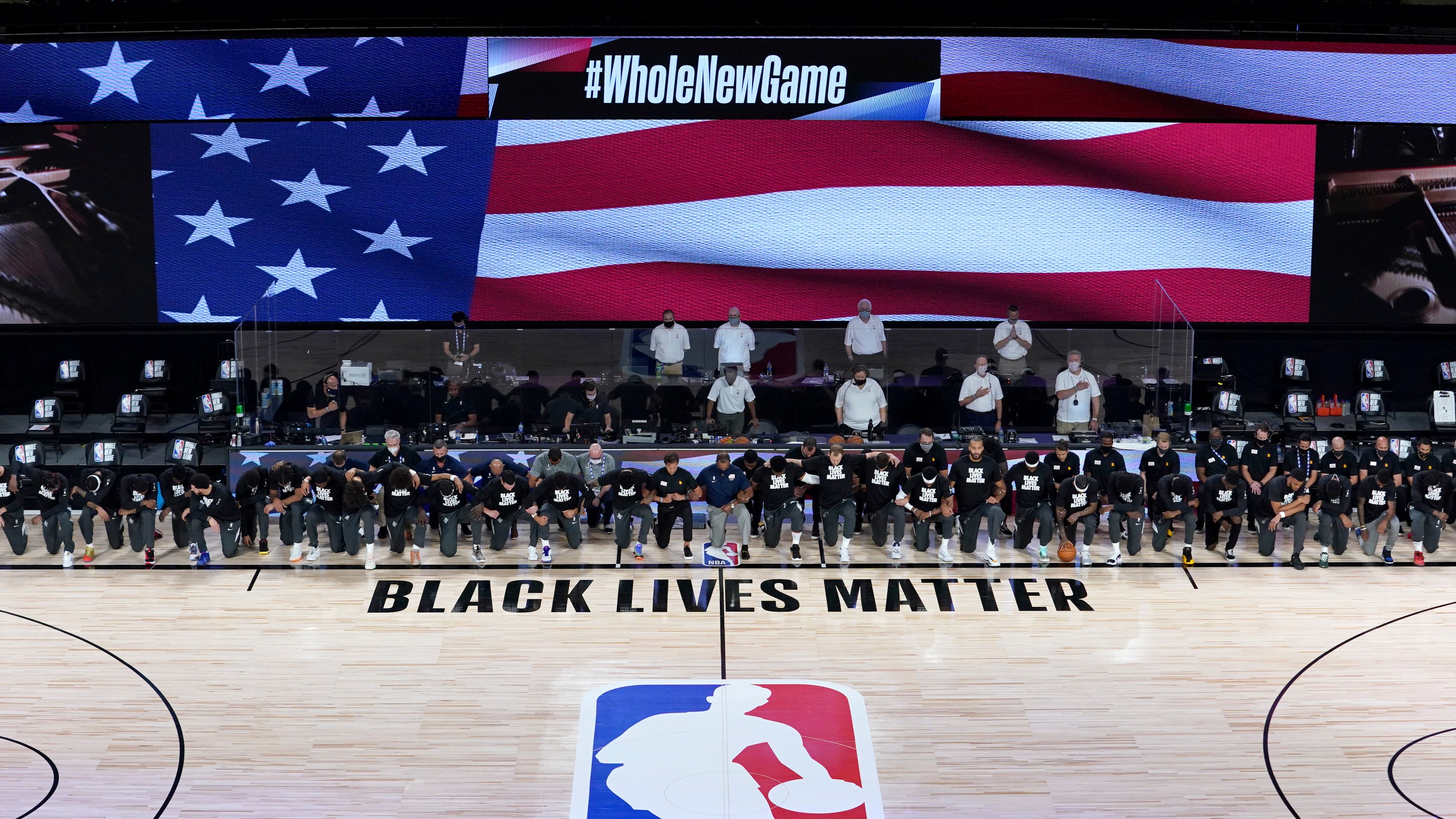 Pelicans and Jazz players kneel for national anthem