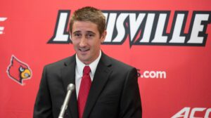 Louisville dismisses 3 soccer players after party leads to COVID-19