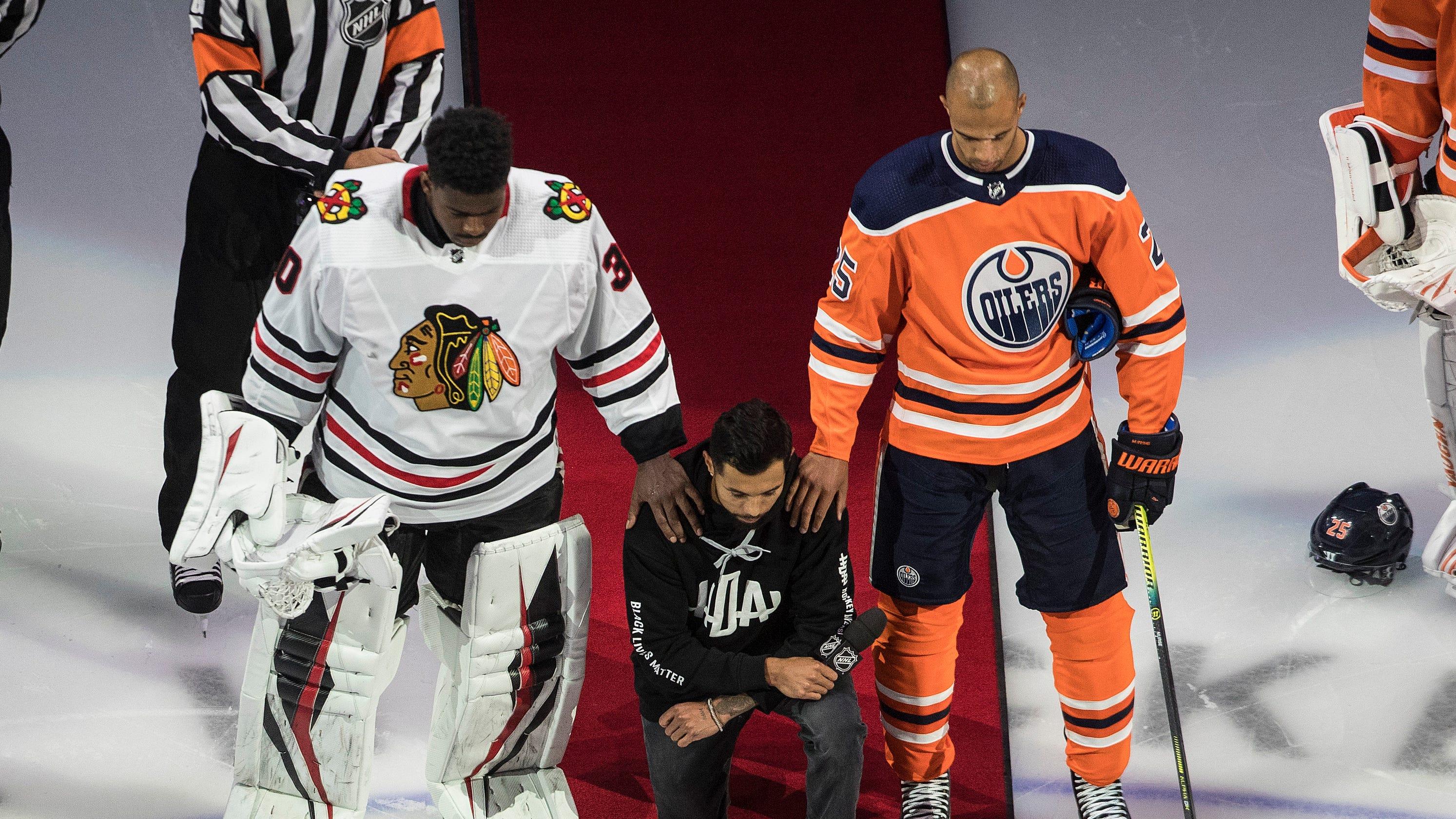 Minnesota Wild's Matt Dumba kneels during anthem after giving anti-racism speech