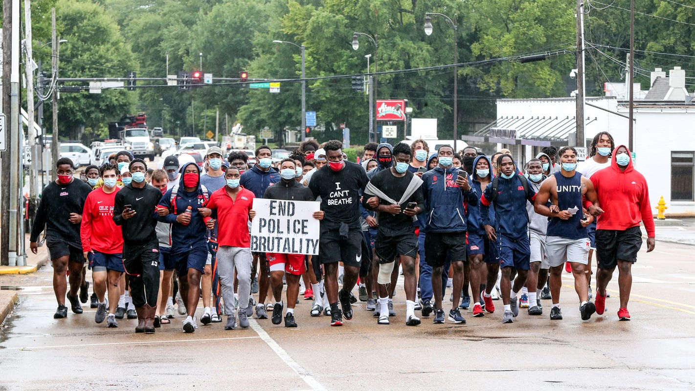 Lane Kiffin, Mississippi football player explain protest march