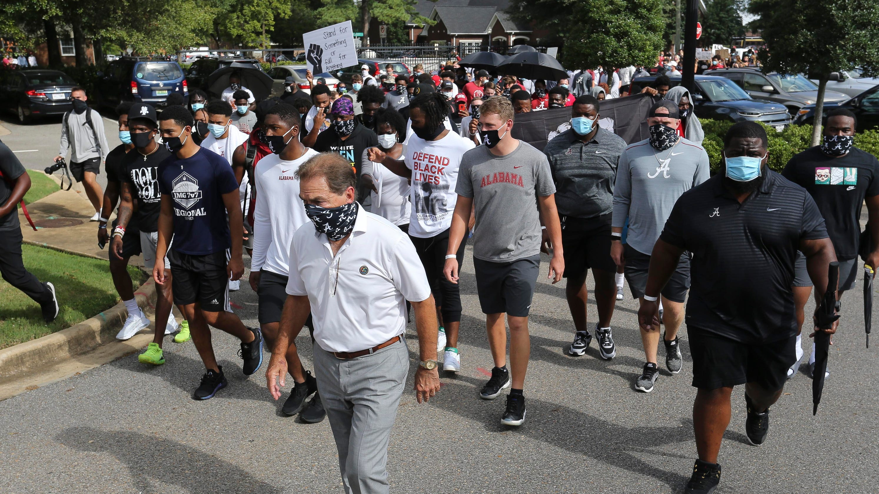 Nick Saban joins Alabama players and coaches in protest march