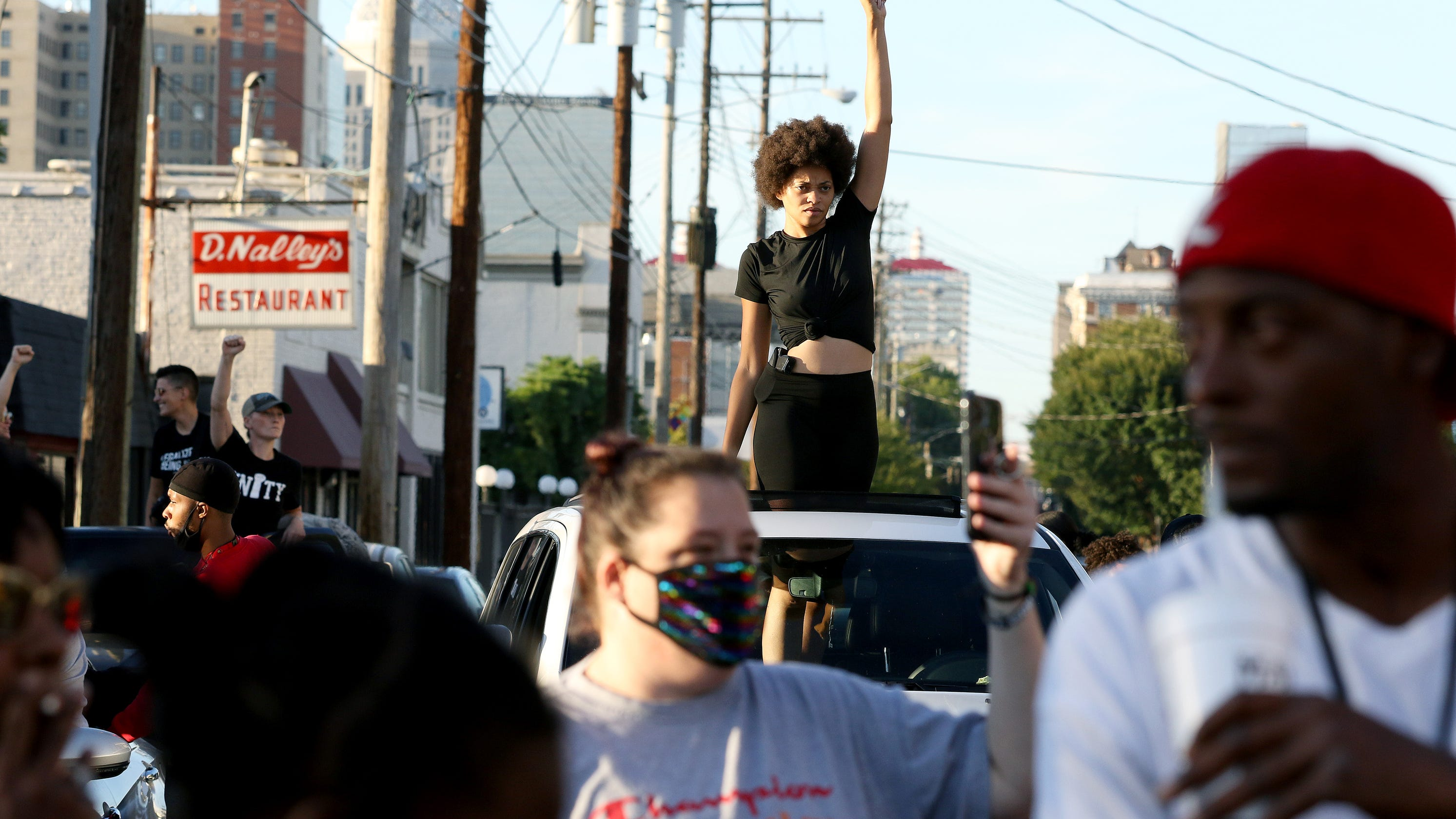 Protests by Breonna Taylor activists, armed march