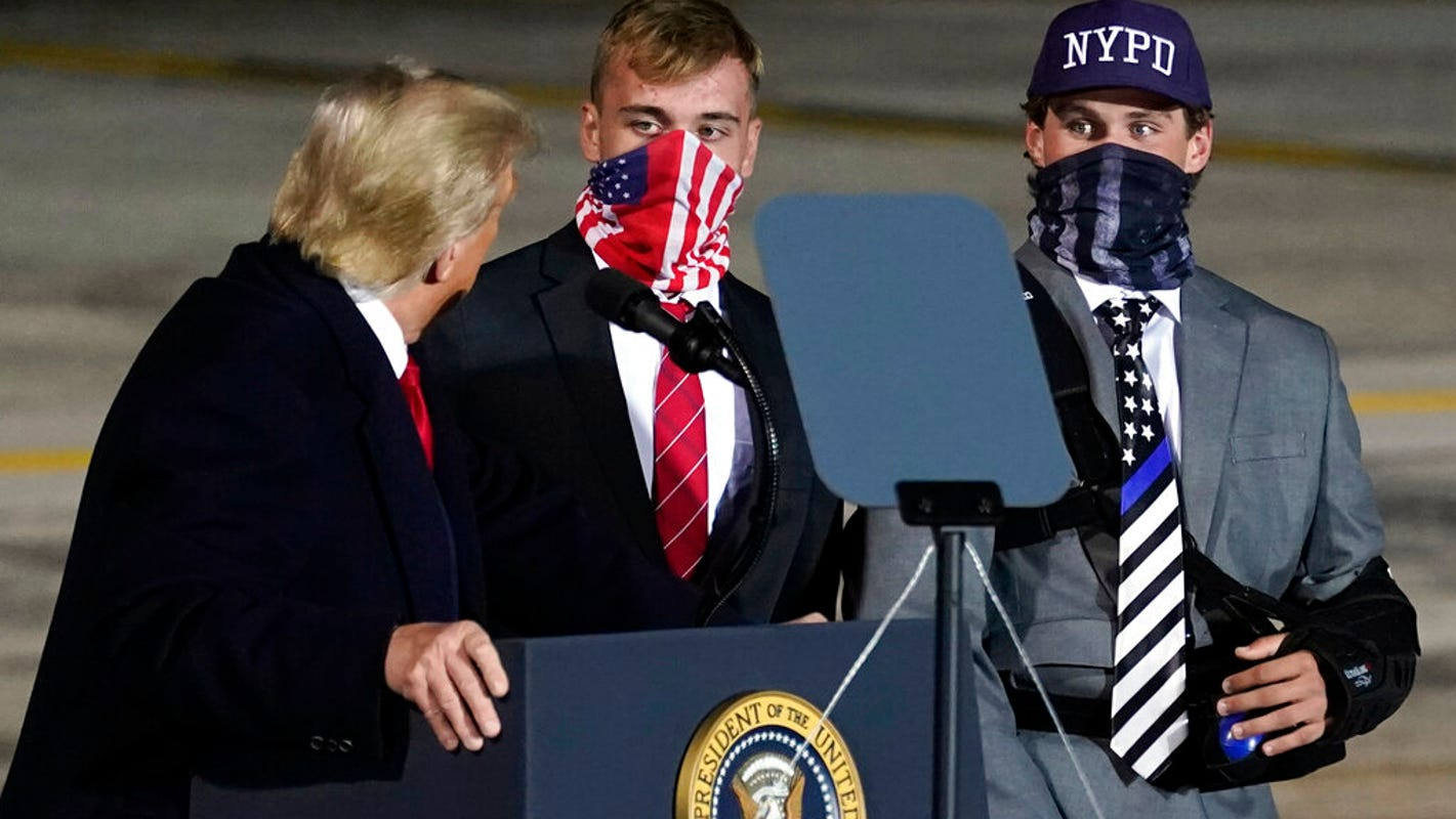 Trump has Little Miami HS players who carried thin-line flags on stage