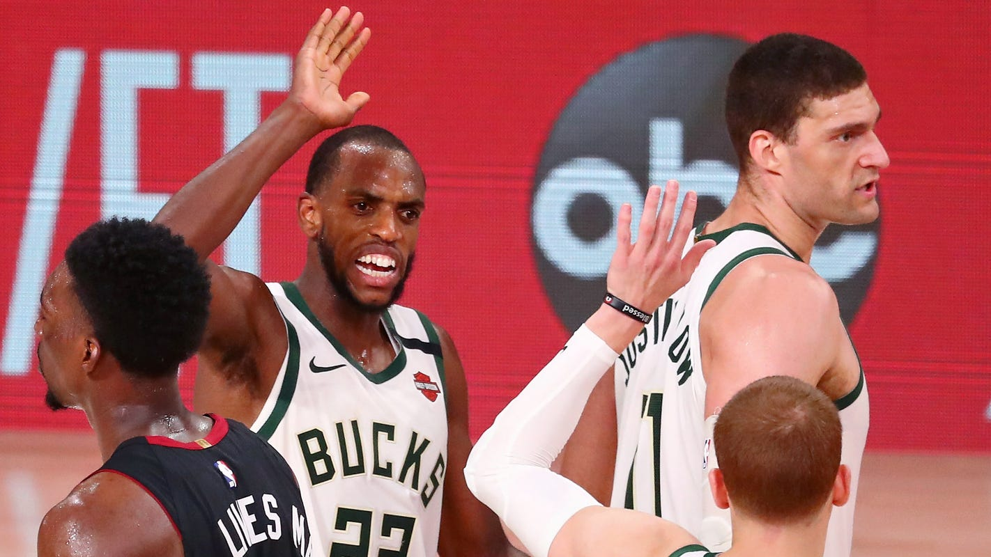 Without Giannis, Bucks hold off Heat to avoid sweep